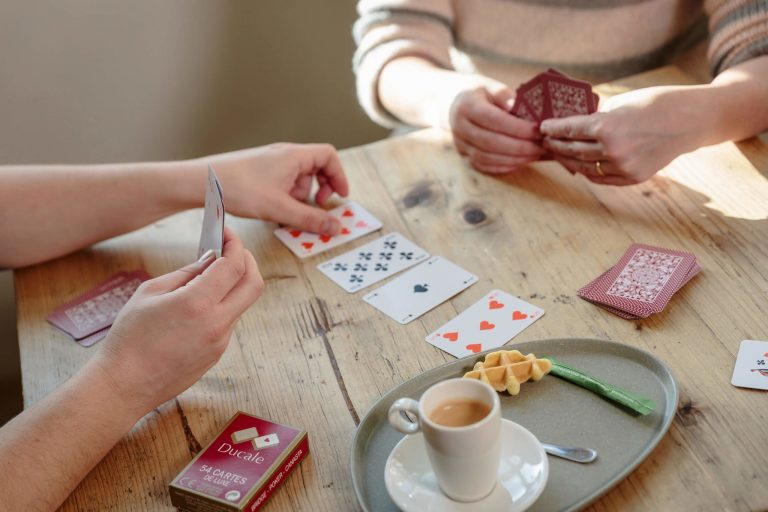 People playing with Ducale Playing cards