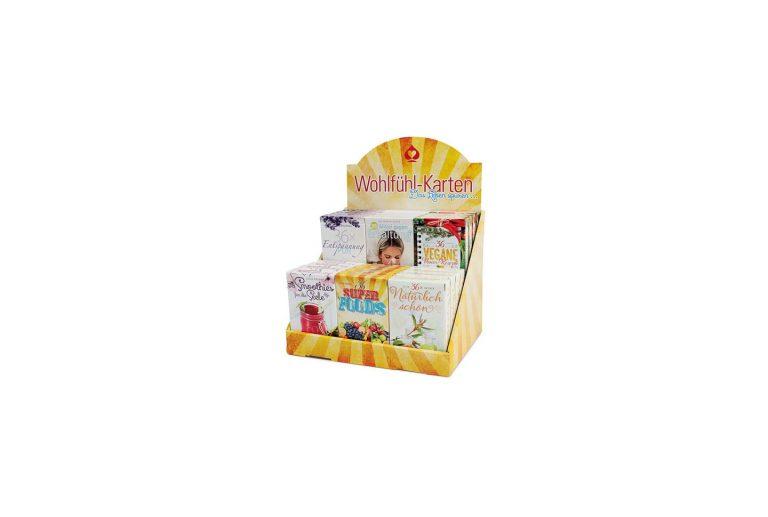 Wellness card games in a display made by Königsfurt Urania