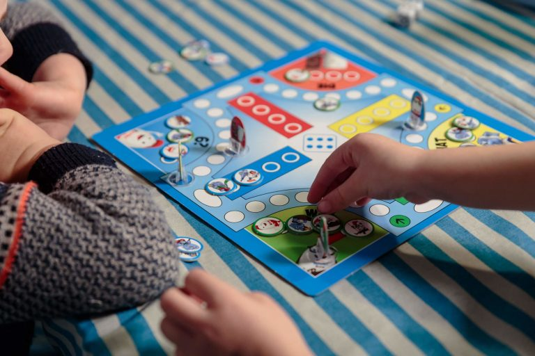 Two children playing a Ferrero Kinder Promotional Board Game