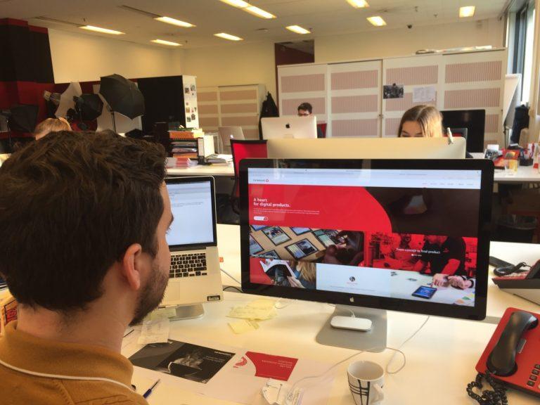 Simon Heylen looking at Cartamundi website on iMac
