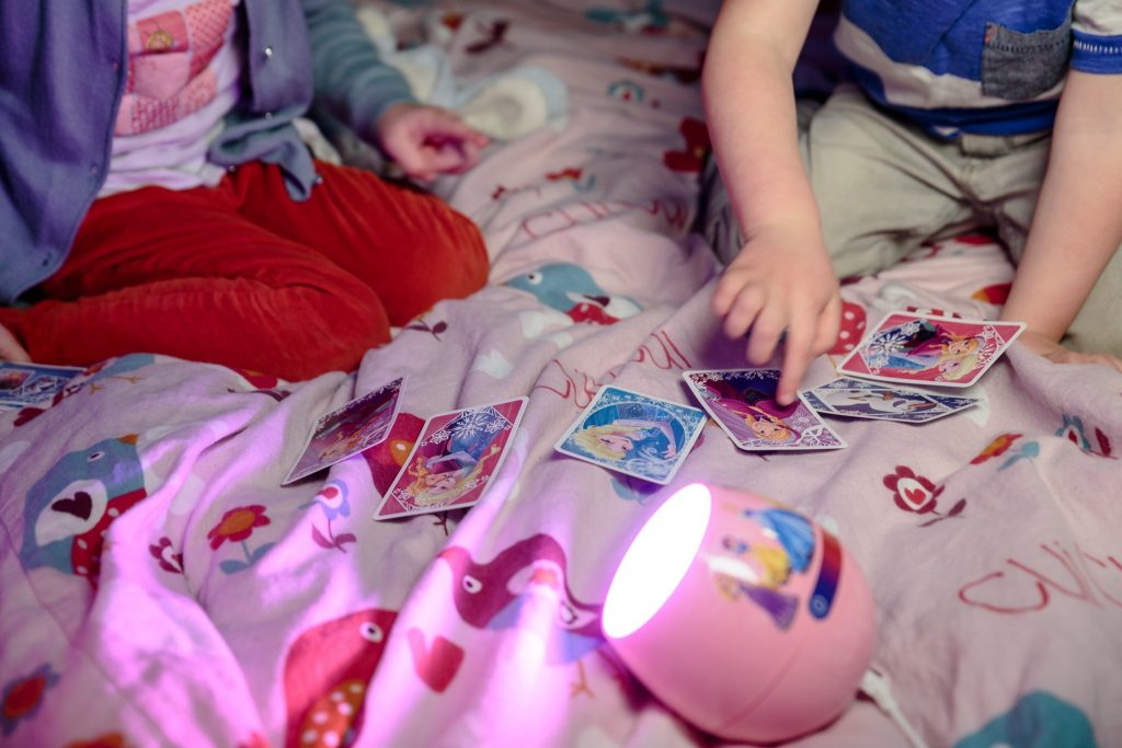 Children playing Happy Families Card Game